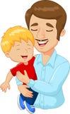 拿着儿子的动画片愉快的家庭父亲 免版税库存图片
