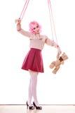 在串的妇女牵线木偶与玩具熊 免版税库存照片