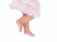 女婴喜欢在桃红色芭蕾舞短裙的一个跳芭蕾舞者 图库摄影