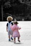 小男婴的女孩 免版税图库摄影