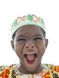 尖叫蓬松卷发的男孩,十岁,被隔绝 库存图片