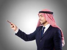 反对梯度的阿拉伯商人 免版税库存照片