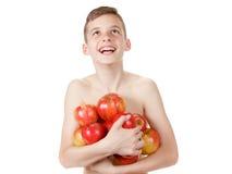 Χαμογελώντας αγόρι με έναν σωρό των μήλων Στοκ φωτογραφίες με δικαίωμα ελεύθερης χρήσης