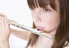 演奏少年的长笛女孩 免版税库存图片