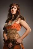 亚马逊的毛皮衣服的妇女 免版税图库摄影