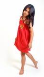 детеныши девушки платья красные Стоковое фото RF
