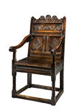 与在白色隔绝的雕刻的老古色古香的橡木壁板椅子 库存照片