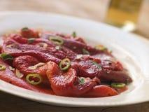 辣椒的果实用卤汁泡的辣椒大蒜烤 库存照片