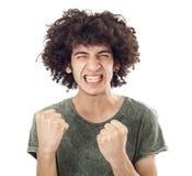 一个年轻人的画象有她的被举的拳头的 免版税库存图片