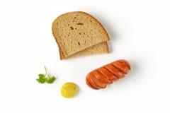 香肠和面包 免版税库存照片