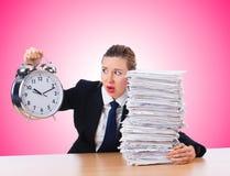 有巨型闹钟的妇女女实业家 免版税库存照片