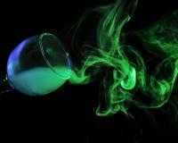 在玻璃的蓝色和绿色烟 万圣节 免版税库存图片