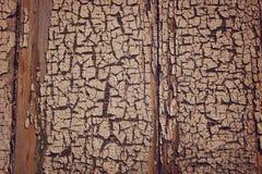 在墙壁上的破裂的油漆 老表面木头 库存图片