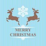 圣诞节标志驯鹿和雪花在蓝色背景 免版税库存图片