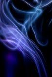 在艺术性黑的背景的抽象五颜六色的数字式烟 免版税库存照片