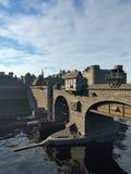中世纪桥梁和老镇有城堡的 免版税库存图片