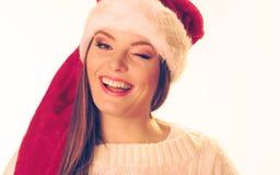 圣诞老人帽子的妇女 免版税库存图片