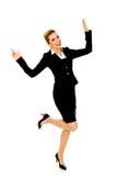 年轻愉快的跳跃的女实业家用手 库存照片