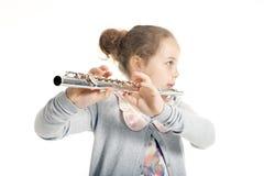 演奏年轻人的长笛女孩 免版税库存图片
