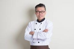 成熟亚洲中国厨师画象 免版税库存图片