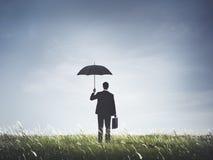 Έννοια ελευθερίας κινδύνου προστασίας ομπρελών επιχειρηματιών Στοκ Φωτογραφίες