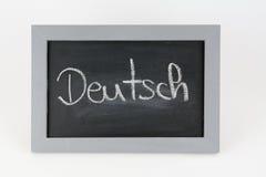 黑板德语 库存照片