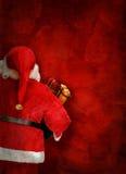 与圣诞老人玩偶的艺术性的贺卡或海报设计 库存图片