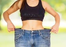 减肥身体成功的饮食的亭亭玉立的腰部 库存照片
