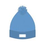 被编织的蓝色帽子 冬天盖帽 冷气候的羊毛辅助部件 库存照片
