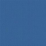 被编织的蓝色纹理 从羊毛无缝的样式的编织 针 免版税图库摄影