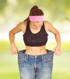 减肥身体成功的饮食的亭亭玉立的腰部 免版税库存照片