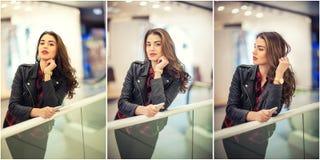 在购物中心射击的有吸引力的少妇时尚 摆在购物中心的黑皮夹克的美丽的时兴的女孩 库存照片