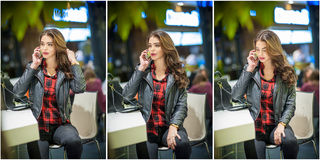 可爱的妇女发表演讲关于在购物中心的机动性 摆在购物中心的黑皮夹克的美丽的时兴的女孩 免版税库存图片
