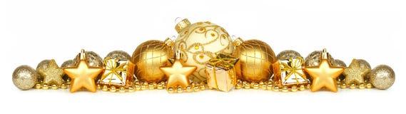 在白色的金黄圣诞节装饰品边界 图库摄影