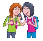 使用他们的手机的青少年的女孩 免版税库存图片