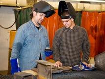 讨论工作焊工 免版税库存照片