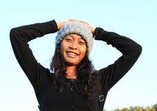 盖帽的热带女孩 图库摄影