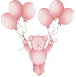 女婴玩具熊的飞行拿着气球 免版税库存照片