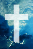 与云彩的基督徒发怒天空 免版税库存照片