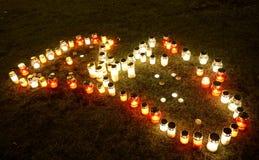 在国家形状的蜡烛  库存图片