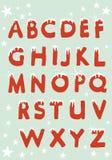 Αλφάβητο Χριστουγέννων που κρεμιέται με το χιόνι Στοκ Φωτογραφία