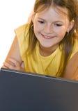 女孩膝上型计算机使用的一点 库存照片