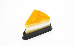 与金蛋黄螺纹的蛋糕 库存图片