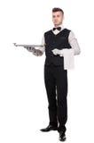 Νεαρό άτομο σε ένα κοστούμι που κρατά έναν κενό δίσκο απομονωμένο στο άσπρο β Στοκ φωτογραφία με δικαίωμα ελεύθερης χρήσης