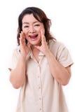 中部年迈的亚洲妇女呼喊 免版税图库摄影