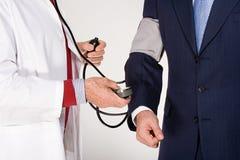 有的商人一医疗检查  免版税库存图片