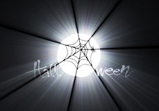 火光万圣节轻的月亮蜘蛛主题 库存照片