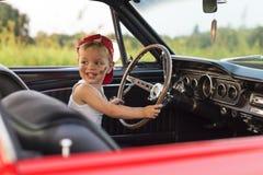 驾驶与他的汽车的男孩 免版税图库摄影