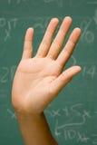 学生用被举的手 免版税图库摄影