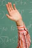 男学生用他的被举的手 免版税图库摄影
